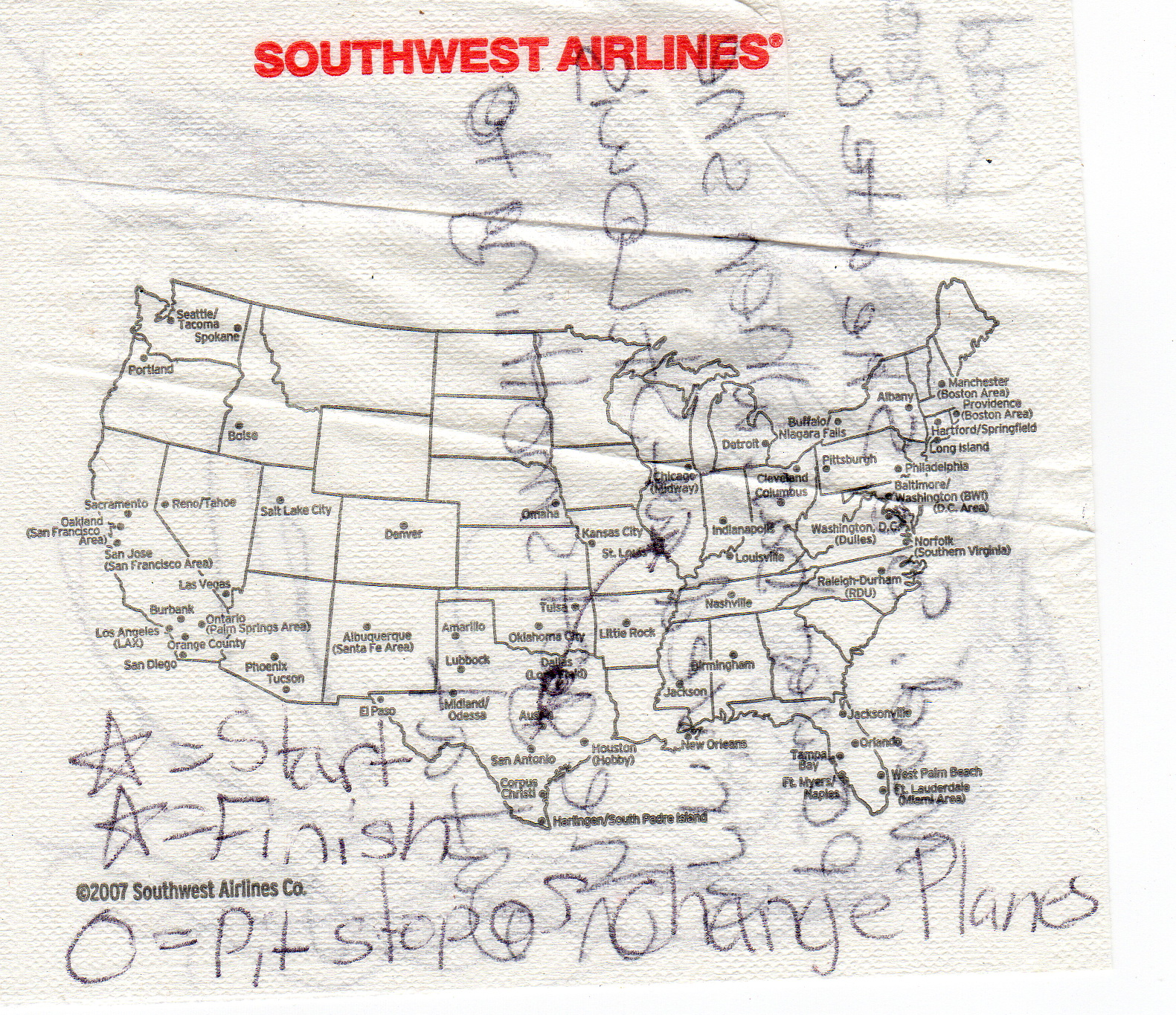 Trip route marked on napkin starting in Austin, pit stop in Dallas, and ending in St. Louis